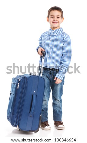 The young traveler boy with a suitcase. Isolated over white background. Vertical view