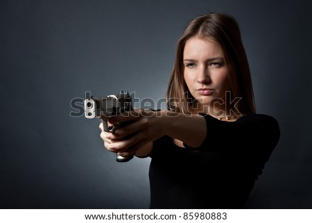 The young woman-agent on a black background