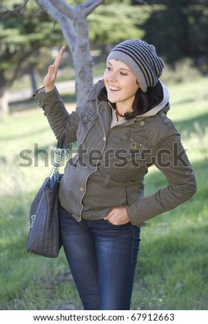 The young woman gesticulates a hand