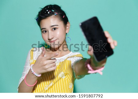 The young woman holding a mobile phone