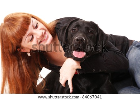 The young woman hugging a mix breed dog