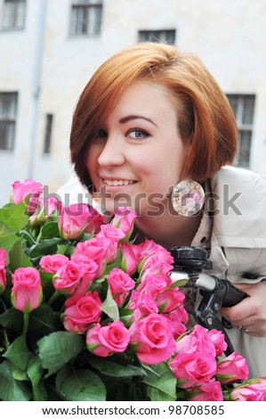 The young woman portrait with roses in the bike