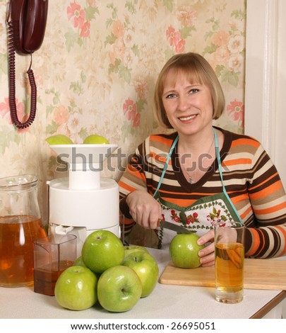 The young woman prepares for apple juice