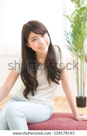 The young woman relaxing in the room