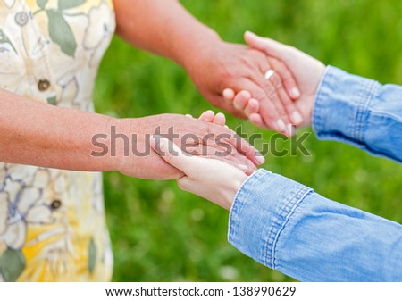 The young woman support the elderly woman