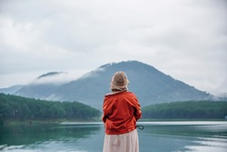 The young women looking at the beautiful view at the lake.Tuyen Lam Lake , Dalat , Vietnam