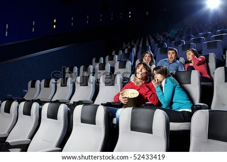 The youth looks a film at a cinema