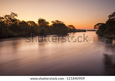 The Zambezi River at dusk, seen from Zambia