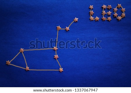 The zodiacal constellation of Leo, the eastern horoscope. Schematic arrangement of stars on a blue surface. Vignetting. The picture is made by the author.
