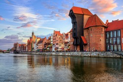 The Zuraw Crane and colorful gothic facades of the old town in Gdansk, Poland, on sunset