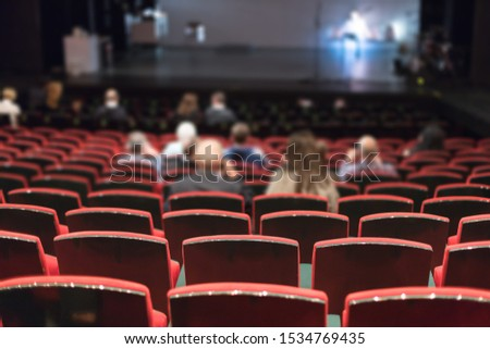 theater audience watching a show #1534769435