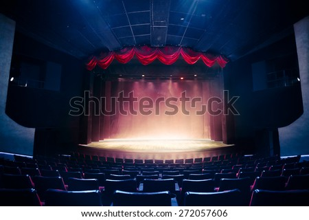 Theater curtain and stage with dramatic lighting #272057606