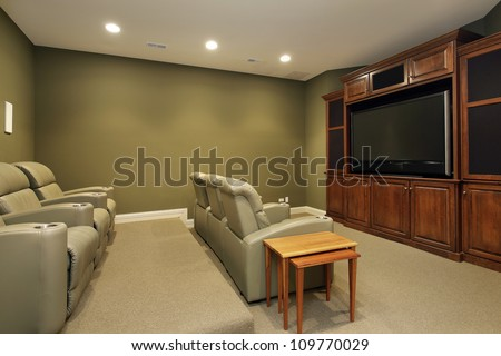 Theater room in luxury home with leather chairs #109770029