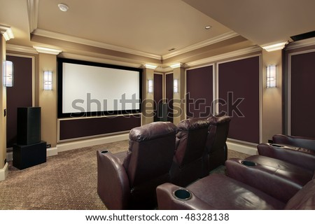 Theater room in luxury home with lounge chairs #48328138