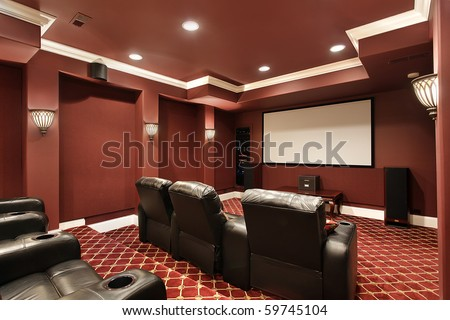 Theater room in luxury home with stadium seating #59745104