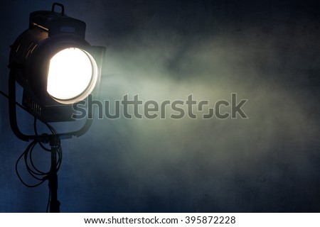 theater spot light with smoke against grunge wall Foto stock ©
