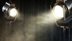 theater spot lights on black curtain with smoke