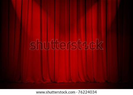 theater stage red curtain with two spotlights cross