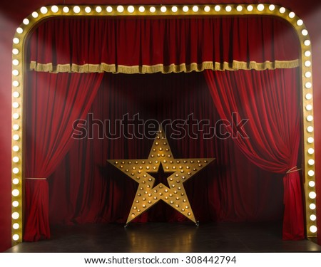 Theater stage with red curtains and spotlights. Theatrical scene in the light of searchlights