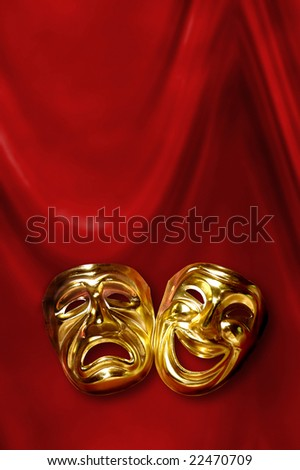 Tragedy And Comedy. stock photo : theatrical mask of tragedy and comedy over a red curtain