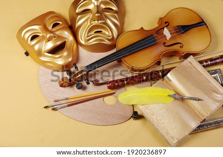 Theatrical masks, art palette, brushes, violin, bow, pipe, fountain pen, book. Attributes of the arts.  Photo stock ©