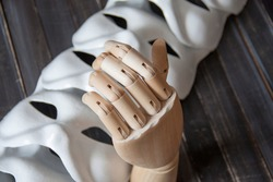 Theatrical masks, props, wooden hand model for artists on the background of theatrical masks