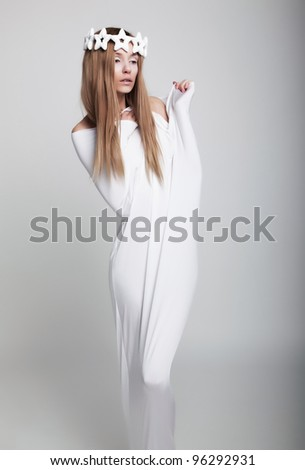 beauty woman in white crown wearing unusual clothes - stock photo