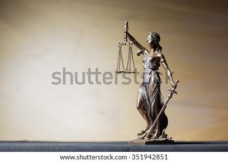 Themis figure on brown background ストックフォト ©
