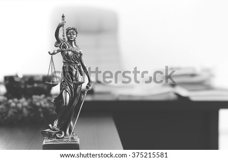 Themis statue in lawyer's office in black and white