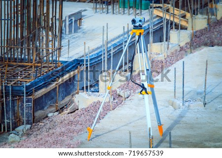 Theodolite at the construction site. Building measurements. Geodetic device on the construction site.