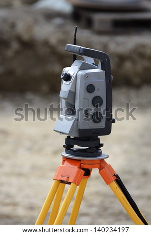 Theodolite on a tripod for surveying on a construction site