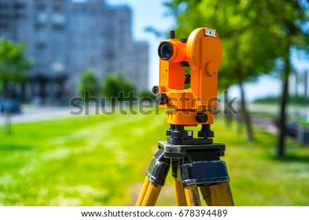 Theodolite orange. Geodesy. Surveying instruments for measuring.