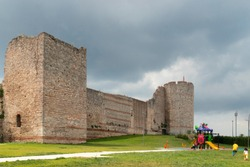 Theodosian Walls of Constantinople after partial restoration. In front of the walls is a children's playground.