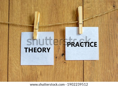 Theory and practice symbol. Wooden clothespins with white sheets of paper. Words 'theory practice'. Beautiful wooden background. Business, theory and practice concept, copy space. ストックフォト ©