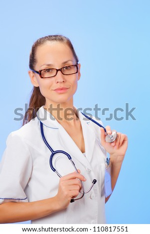Therapeutic doctor (woman) waist-high portrait with stethoscope on blue