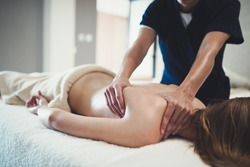 Therapist massaging patient at wellness spa