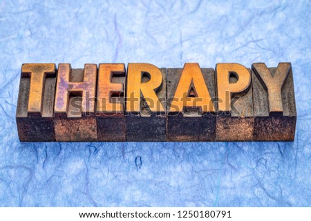 therapy - word abstract in vintage letterpress wood type