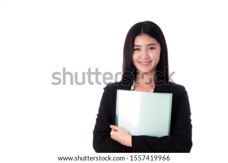 There are a copyspace and isolating. An Asian business woman stands, smiles and hugs the green file firmly on the white background.