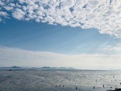 There are clumps of clouds on the mudflats