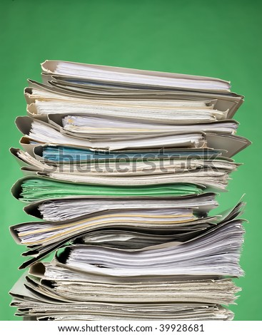 There are documents and papers on green background