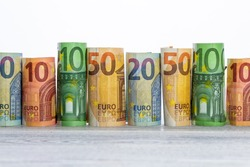 There are euro banknotes against a white background