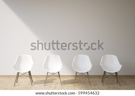 There are four white chairs in a room with gray walls and wooden floor. Concept of a waiting area. 3d rendering, mock up