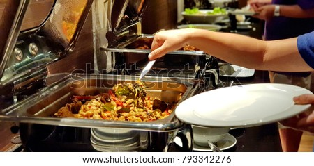 There are many dish of foods in the buffet dinner.