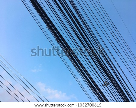 There are many electric wires with sky in the city. #1032700615