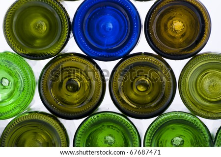 there are many varicoloured bottles on a white background