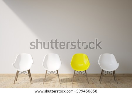 There are three white chairs and a yellow one in a room with gray walls and wooden floor. Concept of a waiting area. 3d rendering, mock up