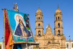 There is a banner of the virgin of Zapopan in front of the basilica.