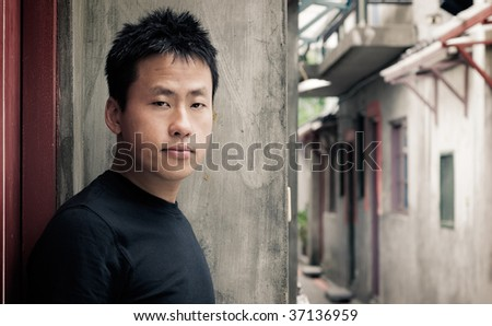 There is a lonely Asian man stand and see. - stock photo