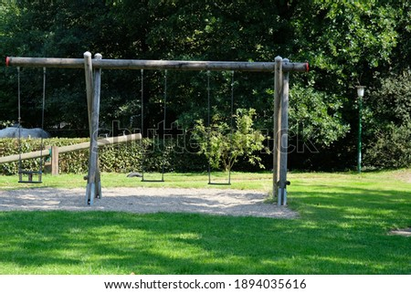 there is a swing on the playground Foto stock ©