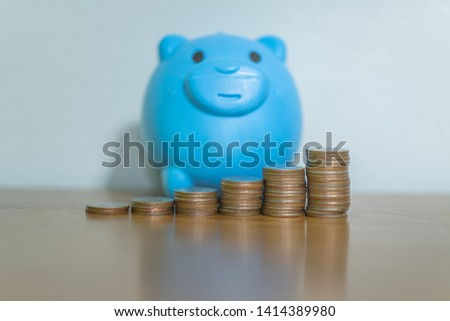 There is money coins to stack of coins. Close up of coins to stack of coins and piggy bank,Money, Financial, Business Growth concept #1414389980
